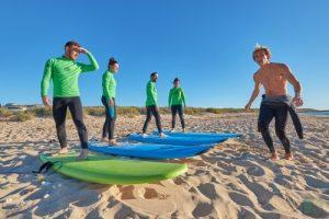 Backpackers taking surfing lesson in Exmouth after the Perth to Exmouth drive